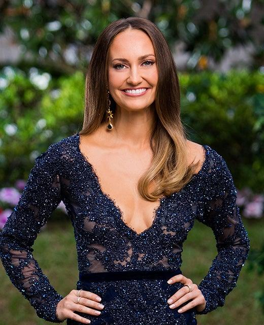 A photo of Bachelor Australia 2019 contestant Emma wearing a blue lace dress.