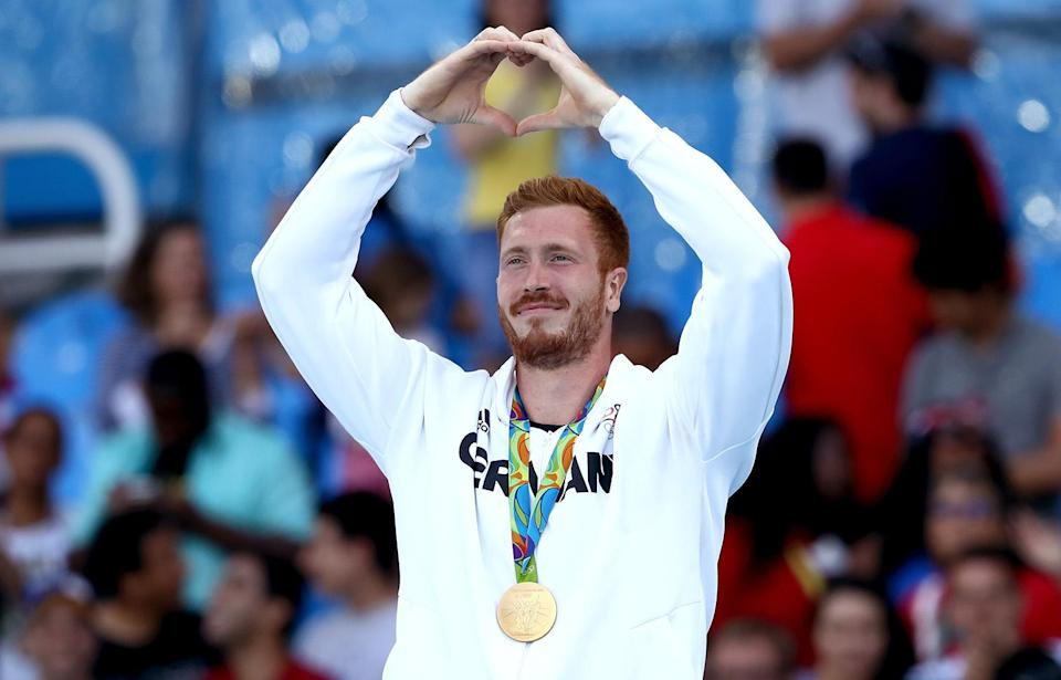 <p>Gold medalist Christoph Harting of Germany poses on the podium during the medal ceremony for the Men's Discus Throw Final on Day 8 of the Rio 2016 Olympic Games at the Olympic Stadium on August 13, 2016 in Rio de Janeiro, Brazil. (Photo by Alexander Hassenstein/Getty Images) </p>