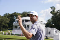 Harris English waves to the crowd after hitting a hole-in-one on No. 15 during the first round of the Tour Championship golf tournament Thursday, Sept. 2, 2021, at East Lake Golf Club in Atlanta. (AP Photo/Brynn Anderson)