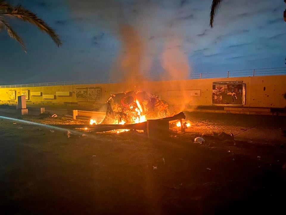This photo released by the Iraqi Prime Minister Press Office shows a burning vehicle at the Baghdad International Airport following an airstrike in Baghdad, Iraq, early Friday, Jan. 3, 2020. The Pentagon said Thursday that the U.S. military has killed Gen. Qassem Soleimani, the head of Iran's elite Quds Force, at the direction of President Donald Trump. (Iraqi Prime Minister Press Office via AP)