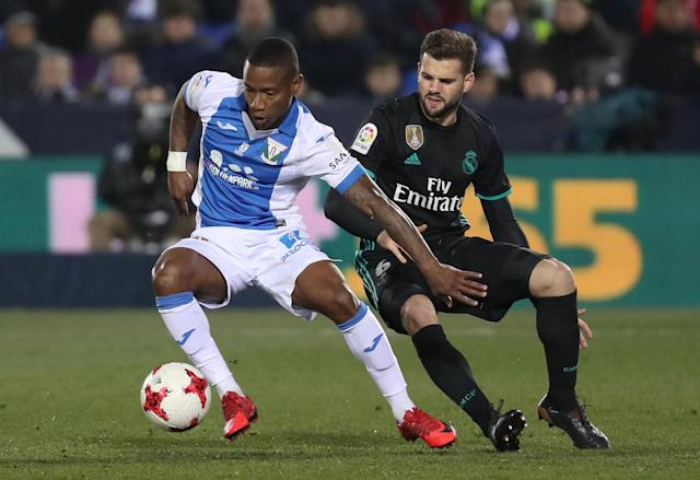 Soccer Football - Spanish King's Cup - Leganes vs Real Madrid - Quarter-Final - First Leg - Butarque Municipal Stadium, Leganes, Spain - January 18, 2018 Leganes' Claudio Beauvue in action with Real Madrid's Nacho REUTERS/Susana Vera