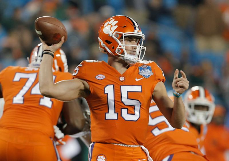 Clemson's Hunter Johnson (15) looks to pass against Miami during the second half of the Atlantic Coast Conference championship NCAA college football game in Charlotte, N.C., Saturday, Dec. 2, 2017. (AP Photo/Bob Leverone)
