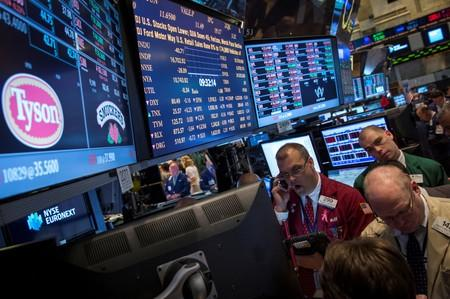 FILE PHOTO: Traders gather at the post that trades Tyson Foods on the floor of the New York Stock Exchange