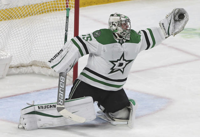Dallas Stars goalie Anton Khudobin makes a glove-save against the Minnesota Wild in the third period of an NHL hockey game Thursday, March 14, 2019, in St. Paul, Minn. Khudobin entered the game in the second period after starting goalie Ben Bishop left after the first period with a lower body injury. (AP Photo/Jim Mone)