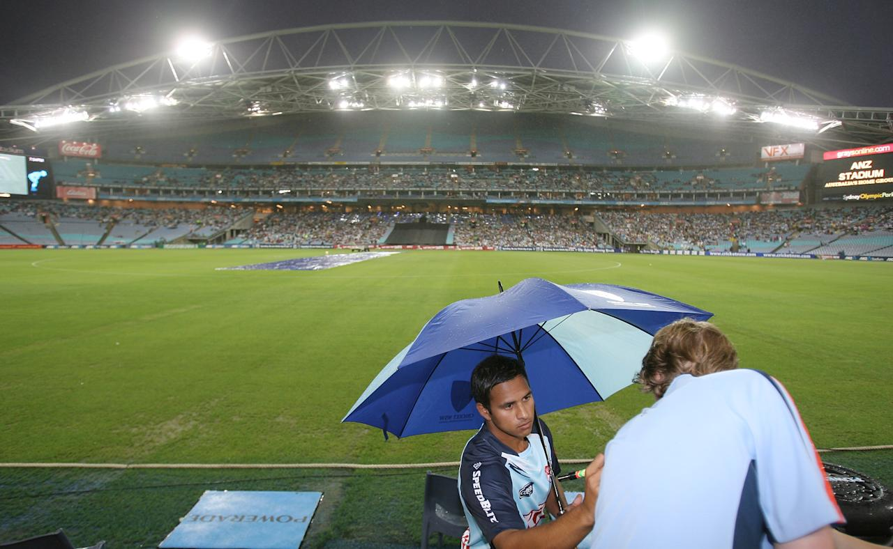 SYDNEY, AUSTRALIA - JANUARY 13:  Usman Khawaja of the Blues signs bats during rain break at the Twenty20 Big Bash match between the New South Wales Blues and the Queensland Bulls at ANZ Stadium on January 13, 2010 in Sydney, Australia.  (Photo by Craig Golding/Getty Images)