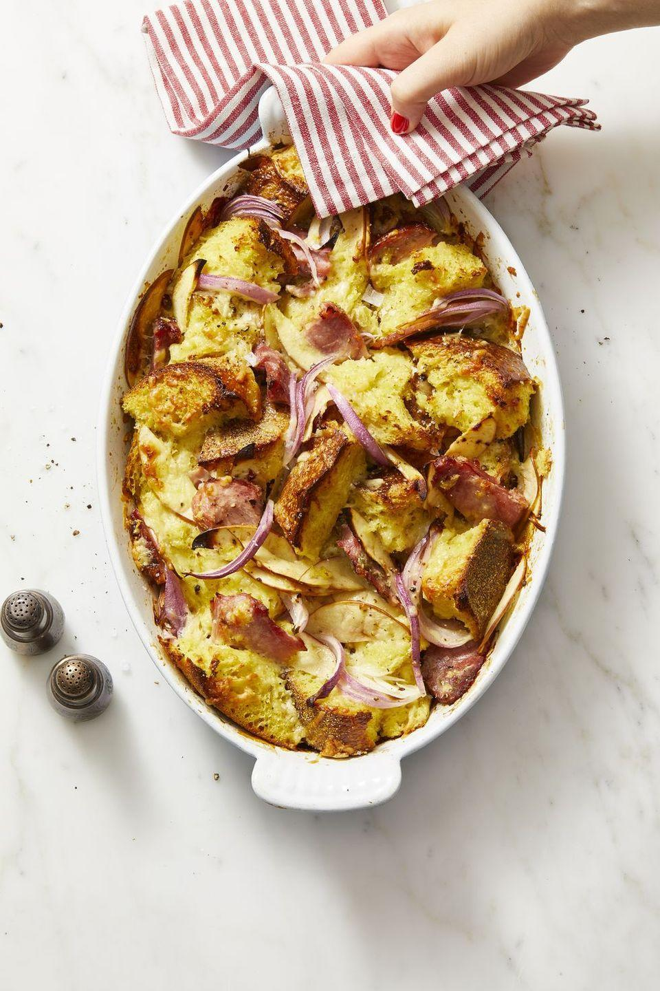 "<p>Fluffy sourdough bread bound by a rich egg mixture and combined with onion, apple, ham and Cheddar makes a breakfast statement that's fit for any holiday.</p><p><em><a href=""https://www.goodhousekeeping.com/food-recipes/a29305072/ham-cheddar-and-red-onion-bread-pudding/"" rel=""nofollow noopener"" target=""_blank"" data-ylk=""slk:Get the recipe for Ham, Cheddar, and Red Onion Bread Pudding »"" class=""link rapid-noclick-resp"">Get the recipe for Ham, Cheddar, and Red Onion Bread Pudding »</a></em></p><p><strong>RELATED: </strong><a href=""https://www.goodhousekeeping.com/holidays/christmas-ideas/g2998/christmas-breakfasts/"" rel=""nofollow noopener"" target=""_blank"" data-ylk=""slk:40 Cozy Breakfasts to Make on Christmas Morning"" class=""link rapid-noclick-resp"">40 Cozy Breakfasts to Make on Christmas Morning</a><br></p>"