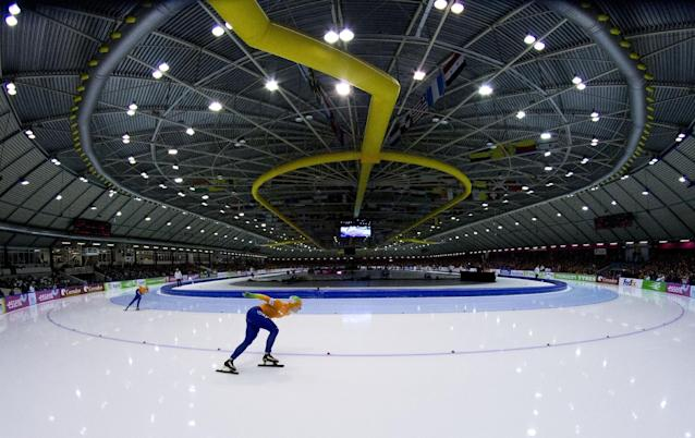 FILE - In this Jan. 13, 2013, file photo, Ireen Wust, center, and Antoinette de Jong , left, of the Netherlands, compete during the women's 1500 meters race at the allround European speedskating championships at Thialf Stadium in Heerenveen, northern Netherlands. Time and again over the last half century, the Dutch are top or near the top of the speedskating standings at any Olympic and for a nation of 16.8 million, it often defies giants like the United States, Russia or Germany. This time too, the Dutch have a realistic chance for a half dozen gold medals on the big oval. (AP Photo/Peter Dejong, File)
