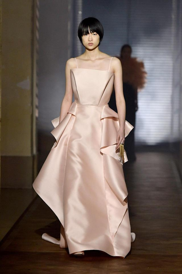 <p>Model wears a blush-pink satin gown from the Givenchy SS18 Haute Couture show. (Photo: Getty Images) </p>