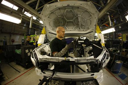 Staff work on the Jaguar XJ production line at their Castle Bromwich Assembly Plant in Birmingham