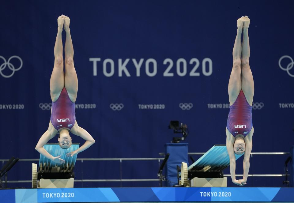 Alison Gibson and Krysta Palmer of the United States' compete during the Women's Synchronized 3m Springboard Final at the Tokyo Aquatics Centre at the 2020 Summer Olympics, Sunday, July 25, 2021, in Tokyo, Japan. (AP Photo/Dmitri Lovetsky)