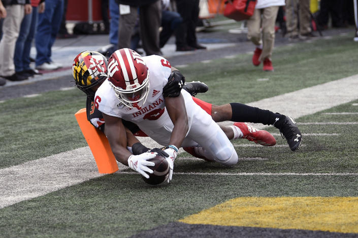 Indiana wide receiver Donavan Hale (6) scores a touchdown against Maryland defensive back Nick Cross (3) during the first half of an NCAA college football game, Saturday, Oct. 19, 2019, in College Park, Md. (AP Photo/Nick Wass)