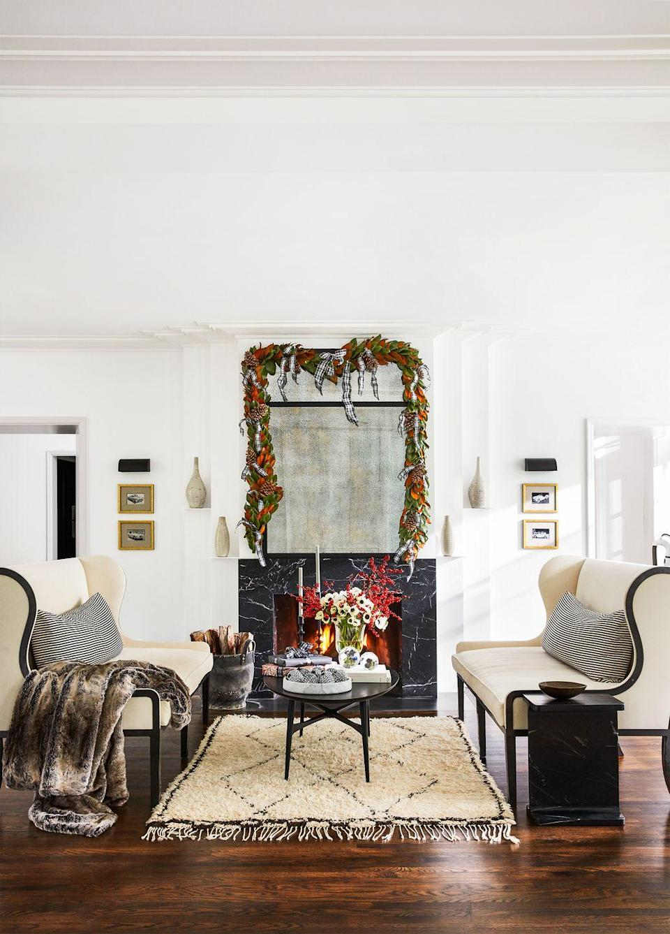 """<p>Another option if you don't want a ribbon on your tree but want to display the accent in some way: Add it to a garland over your mantel. This elevated one in the home of CB2 president <a href=""""https://www.housebeautiful.com/entertaining/holidays-celebrations/g22996924/fireplace-christmas-mantel-decorations/"""" rel=""""nofollow noopener"""" target=""""_blank"""" data-ylk=""""slk:Ryan Turf"""" class=""""link rapid-noclick-resp"""">Ryan Turf</a> features hanging pieces of ribbon throughout.</p>"""