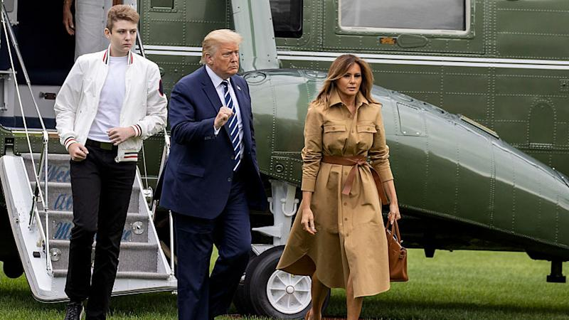 Barron Trump, Donald Trump and Melania Trump walk on the South Lawn of the White House on August 16, 2020 in Washington, DC.