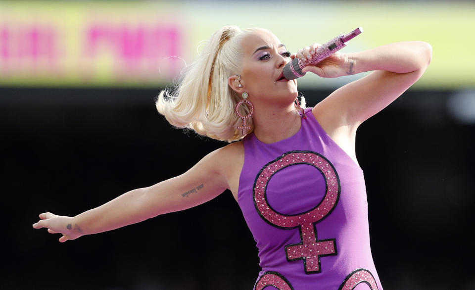 """FILE - In this Sunday, March 8, 2020, file photo, Katy Perry performs before the start of the Women's T20 World Cup cricket final match between Australia and India in Melbourne. A federal judge has given Perry a major victory in the dispute over her song """"Dark Horse,"""" overturning a jury's verdict that found the pop superstar and her collaborators copied the 2013 hit """"Dark Horse,"""" from a 2009 song by Christian rapper Marcus Gray. (AP Photo/Asanka Ratnayake, File)"""