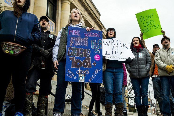 A protest outside the Federal Building in Flint, Mich., Jan. 25, 2017, against the city's water crisis. (Photo: Jake May/The Flint Journal-MLive.com via AP)