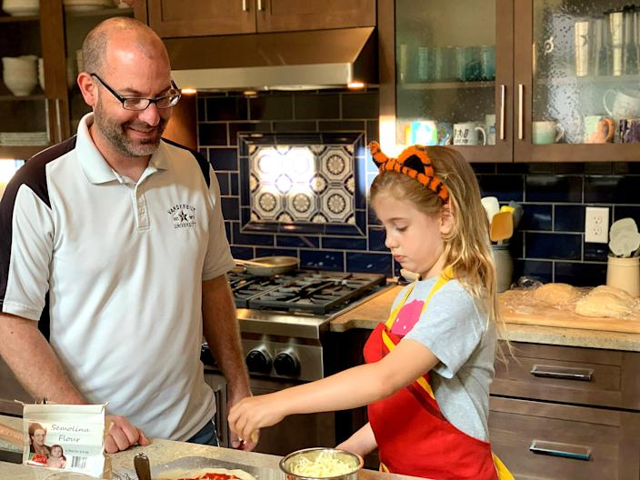Chris Murdock and his daughter cooking in the kitchen. (Courtesy Chris Murdock)