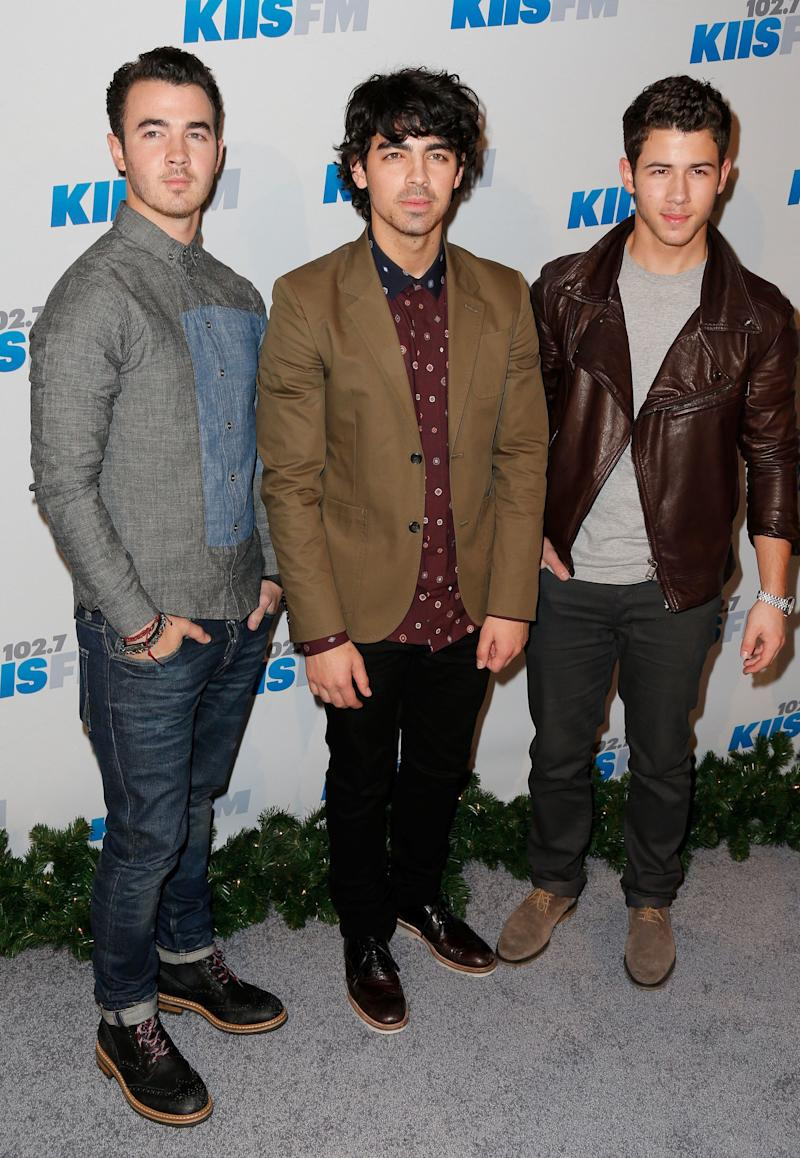 LOS ANGELES, CA - DECEMBER 01: (L-R) Musicians Kevin Jonas, Joe Jonas and Nick Jonas of the Jonas Brothers attend KIIS FM's 2012 Jingle Ball at Nokia Theatre L.A. Live on December 1, 2012 in Los Angeles, California. (Photo by Imeh Akpanudosen/Getty Images)