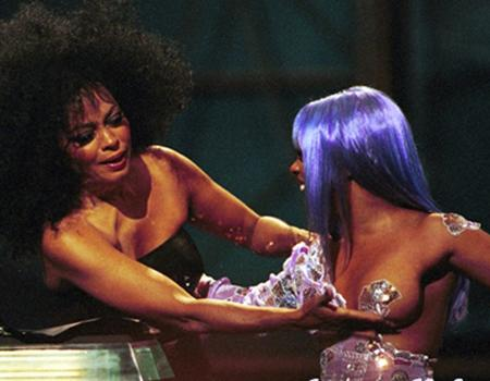 <p>Diana Ross got 'up close and personal' with rapper Lil' Kim at the 1999 MTV VMAS! Diana decided to fondle Lil Kim's breast to the beat of the DJ's music. Interesting...</p>