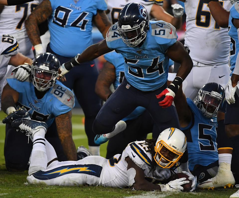 Oct 20, 2019; Nashville, TN, USA; Los Angeles Chargers running back Melvin Gordon (25) is stopped short of the goal line by Tennessee Titans inside linebacker Rashaan Evans (54) during the second half at Nissan Stadium. Mandatory Credit: Christopher Hanewinckel-USA TODAY Sports
