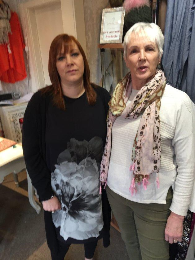 Kate Mills (left) and Sarah Haydon (right) in Haydon's dress shop.