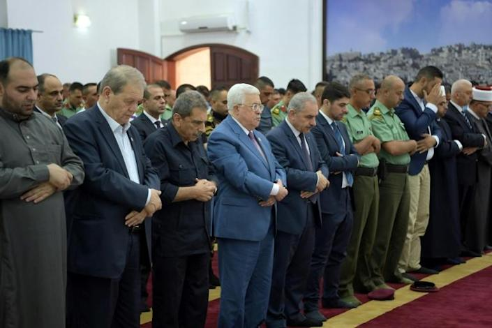 Palestinian President Mahmud Abbas (4th L) had accused Israel of blackmail through its withholding of funds, insisting on the full amount, which accounts for around 65 percent of PA revenues. (AFP Photo/THAER GHANAIM)