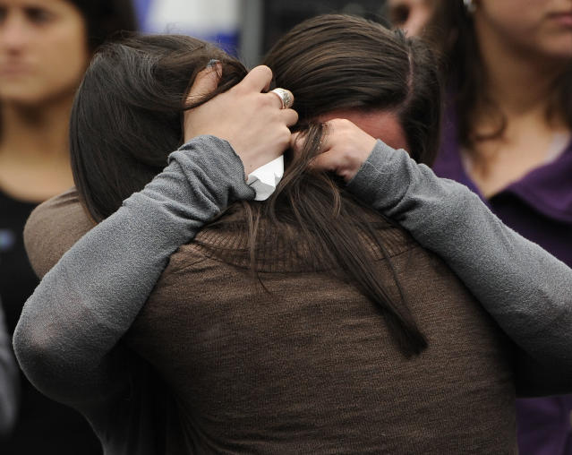 Carlee Soto, front, and Jillian Soto, sisters of slain teacher Victoria Soto, embrace during a ceremony on the six-month anniversary honoring the 20 children and six adults gunned down at Sandy Hook Elementary School on Dec. 14, 2012 in Newtown, Conn., Friday, June 14, 2013. Newtown held a moment of silence Friday for the victims of the massacre at Sandy Hook Elementary School at a remembrance event that doubled as a call to action on gun control, with the reading of names of thousands of victims of gun violence. (AP Photo/Jessica Hill)