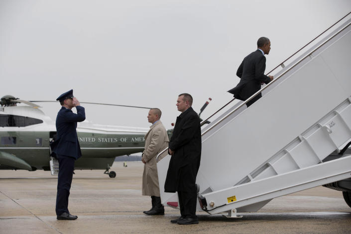 """President Barack Obama boards Air Force One at Andrews Air Force Base, Md., Wednesday, Feb. 19, 2014, prior to traveling to Toluca, Mexico to participate in the seventh trilateral North American Leaders Summit Meeting, where he will meet with Canadian Prime Minister Stephen Harper and Mexican President Enrique Peña Nieto. This year's theme is """"North American Competitiveness.""""(AP Photo/Jacquelyn Martin)"""