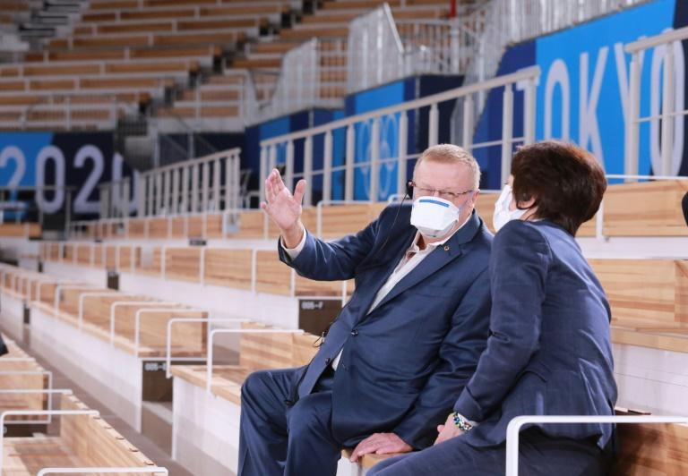 International Olympic Committee Vice President John Coates (L) talks with Tokyo 2020 President Seiko Hashimoto during their inspection of the Ariake Gymnastics Centre in Tokyo on June 23, 2021