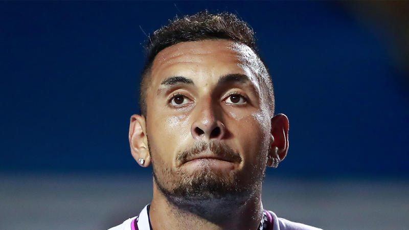 Nick Kyrgios looking dejected during a match.