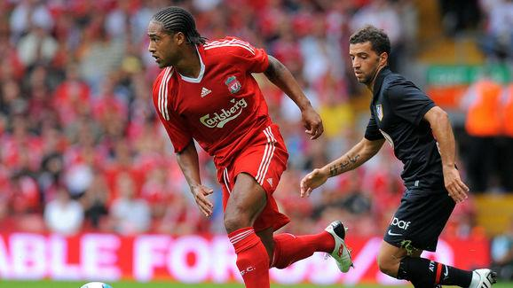 Liverpool's Glen Johnson (L) vies with A