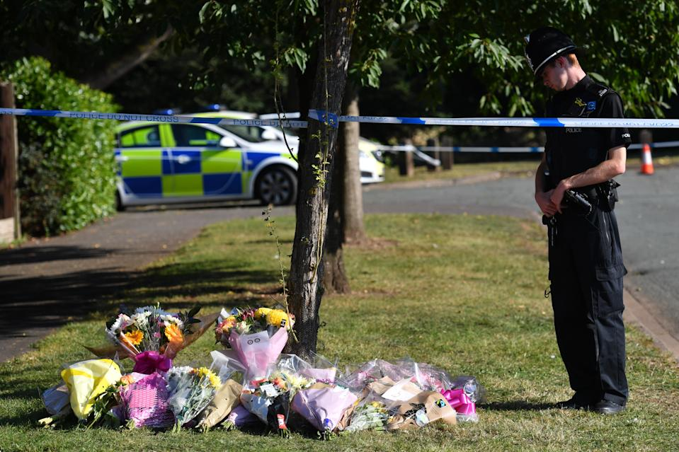 Floral tributes placed in Edgar Close, next to Wigginton Park, Tamworth, Stafffordshire after a 20-year-old woman died there on Thursday evening. Police believe the young woman is Keeley Bunker.