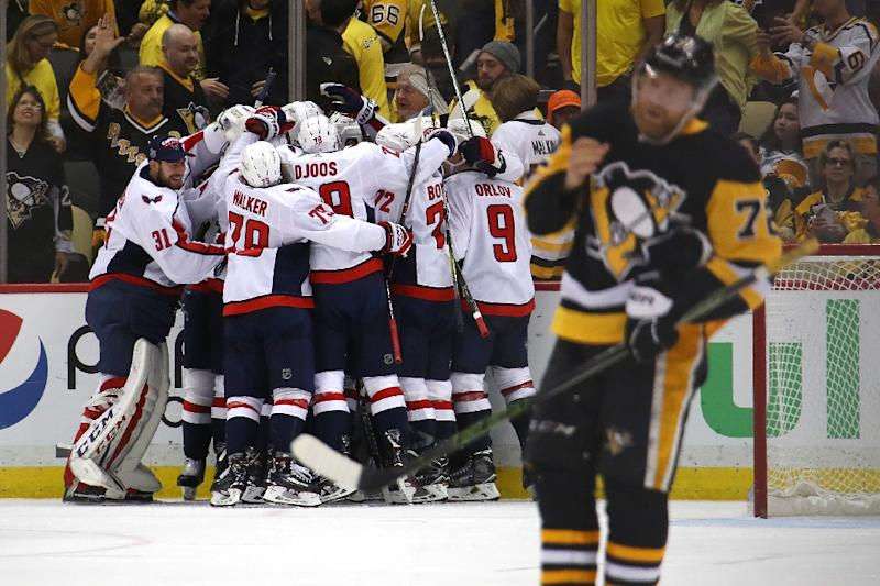 The Washington Capitals celebrate a 2-1 overtime win against the Pittsburgh  Penguins to move 48e9b3307a2