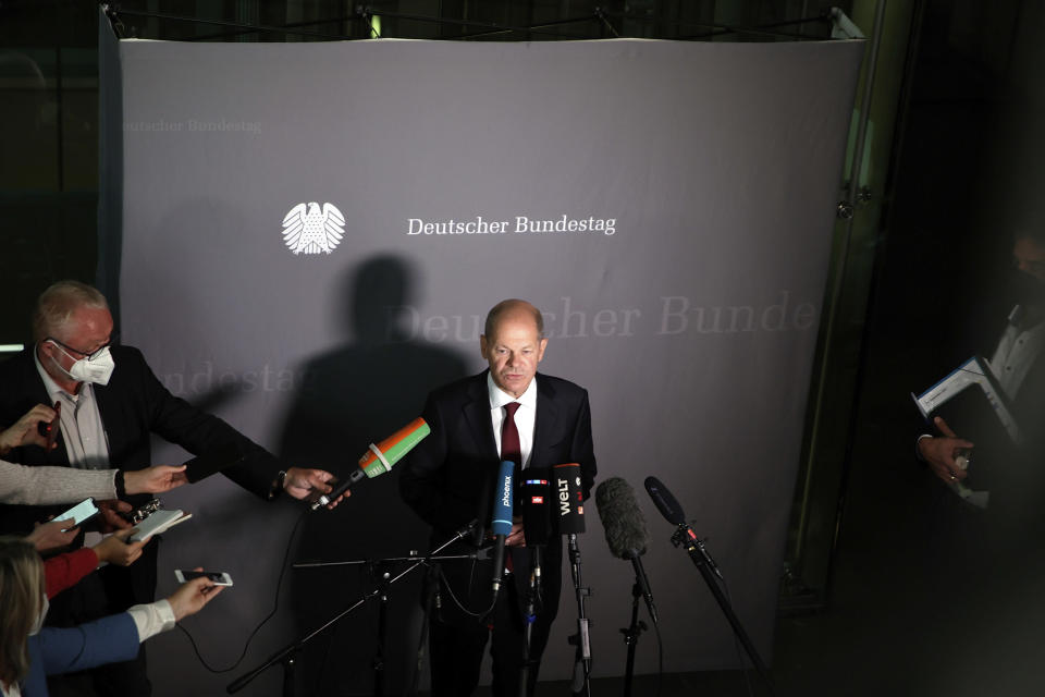 Olaf Scholz, Federal Minister of Finance, and SPD top candidate for chancellor at the forthcoming elections, speaks to journalists after the hearing before the Bundestag Finance Committee in Berlin, Germany, Monday, Sept. 20, 2021. Scholz was to answer questions about the search of his ministry in connection with money laundering investigations. (Carsten Koall/dpa via AP)