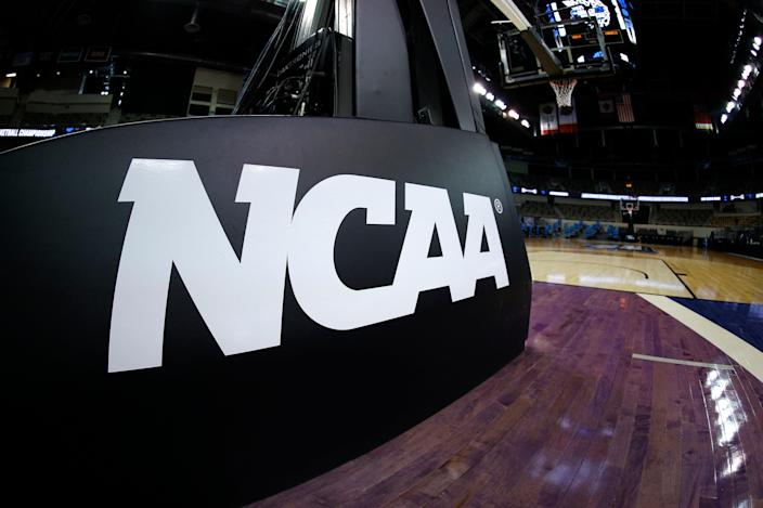 <p>The NCAA logo is seen on the basket stanchion before the game between the Oral Roberts Golden Eagles and the Florida Gators in the second round game of the 2021 NCAA Men's Basketball Tournament at Indiana Farmers Coliseum on March 21, 2021 in Indianapolis, Indiana.</p> (Photo by Maddie Meyer/Getty Images)