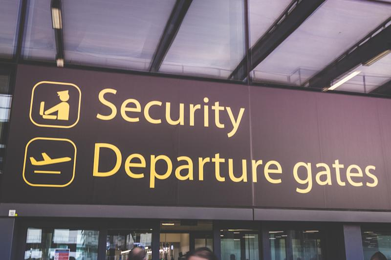 London, England - may 30, 2017: Information sign showing way to departure gates and security at Heathrow Airport in London, England.
