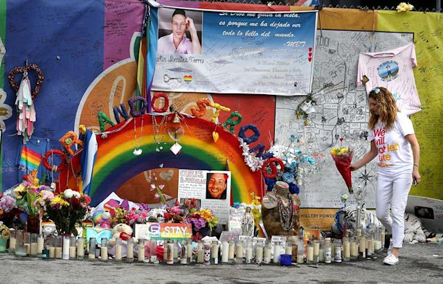 <p>Pulse nightclub owner Barbara Poma tends to the memorial in front of her club on Saturday, June 10, 2017, in Orlando, Fla. (Joe Burbank/Orlando Sentinel/TNS via Getty Images) </p>