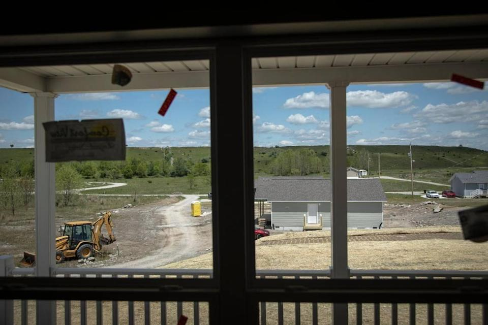 Houses in various stages of construction by nonprofit Housing Development Alliance on Wells Mountain where there used to be a strip mine outside of Hazard, Ky., Tuesday, May 11, 2021. The HDA recently announced a 15-house subdivision to be constructed in Allais, area of Hazard.