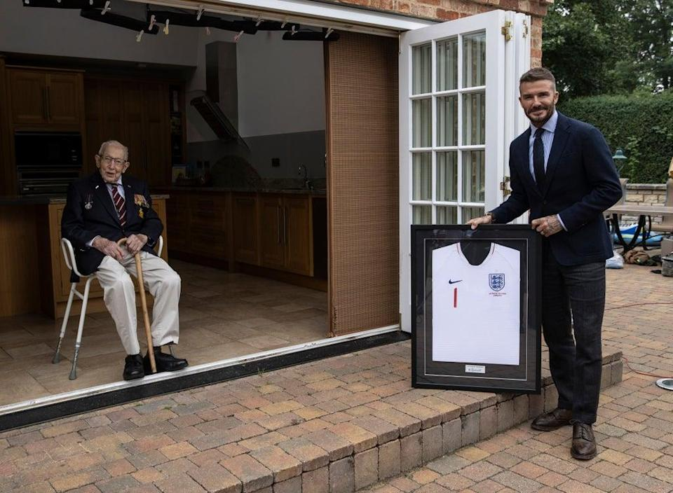 Captain Sir Tom Moore is given a framed England shirt by David Beckham after he became the first member of the Lionhearts squad of inspirational heroes (Eddie Keogh/The FA0 (PA Media)