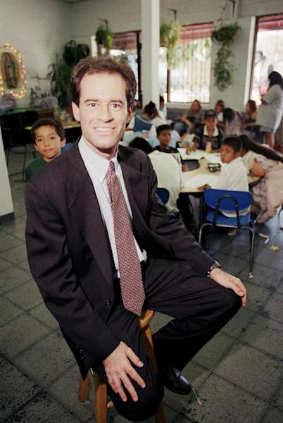 FILE - In this Aug. 27, 1997 file photo, Ron Unz, poses inside the Las Families Del Pueblo child care center in Los Angeles. Unz, a Silicon Valley multimillionaire and registered Republican who once ran for governor and, briefly, U.S. Senate, wants state voters to endorse the wage jump that he predicts would nourish the economy and lift low-paid workers from dependency on food stamps and other assistance bankrolled by taxpayers. Two decades ago, Unz tried to unseat then-Gov. Pete Wilson, a fellow Republican. After a long break on the political sidelines, Unz's reappearance has startled members of both major parties, and his proposal, if it goes to voters in November, could unsettle races from governor to Congress. (AP Photo/Kevork Djansezian)