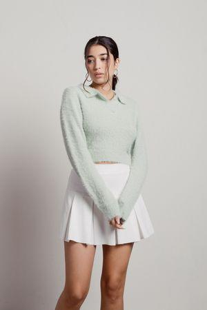 """<p><strong>Tobi</strong></p><p>tobi.com</p><p><strong>$45.00</strong></p><p><a href=""""https://www.tobi.com/product/76658-tobi-whisper-softly-collared-sweater?color_id=108899"""" rel=""""nofollow noopener"""" target=""""_blank"""" data-ylk=""""slk:Shop Now"""" class=""""link rapid-noclick-resp"""">Shop Now</a></p><p>Technically, you could pair this fuzzy collared sweater with anything to give off major preppy chic vibes, but not matching it with your fave <a href=""""https://www.womenshealthmag.com/fitness/g36945633/best-white-tennis-skirts/"""" rel=""""nofollow noopener"""" target=""""_blank"""" data-ylk=""""slk:white tennis skirt"""" class=""""link rapid-noclick-resp"""">white tennis skirt</a> is a total missed opportunity. </p>"""