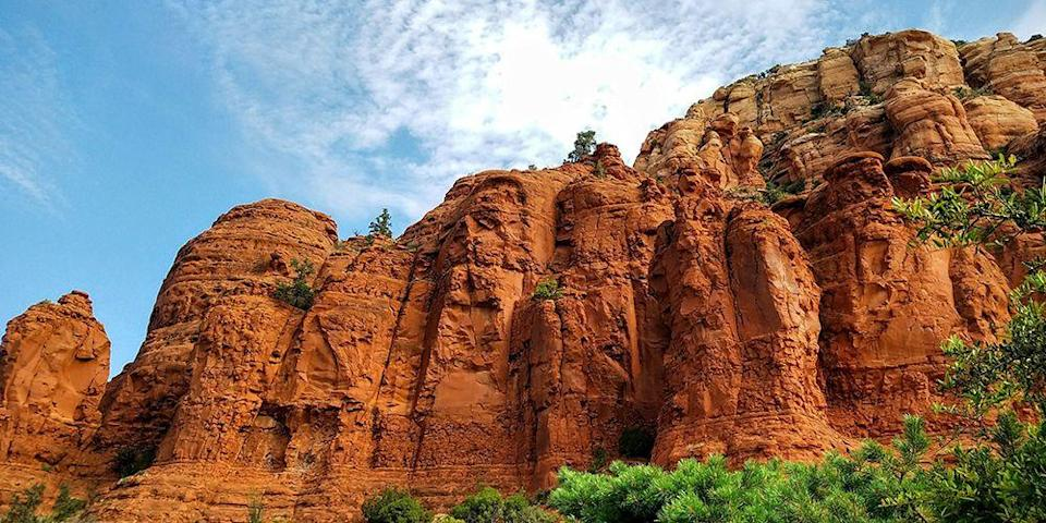 """<p>Be prepared to be blown away by the beauty of Sedona's <a href=""""https://www.tripadvisor.com/Attraction_Review-g31352-d109098-Reviews-Red_Rock_State_Park-Sedona_Arizona.html"""" rel=""""nofollow noopener"""" target=""""_blank"""" data-ylk=""""slk:Red Rocks"""" class=""""link rapid-noclick-resp"""">Red Rocks</a>, an artsy and adventure-minded town known for its spiritual vortexes, which are thought to be energy centers that can help you heal and strengthen your inner balance. In town, you can get readings, aura photos, and healing crystals if you're into that sort of thing, but all you really need to do is get out among the ancient red and pink canyons, mesas, and buttes to feel a more mellow vibe. </p>"""