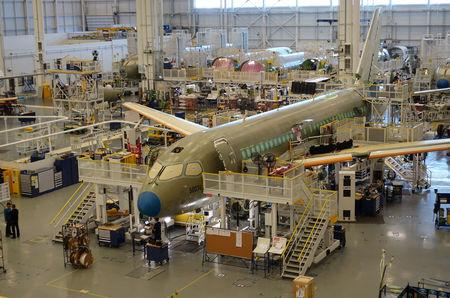 An Airbus A220 passenger jet stands in the final assembly line, where the European company plans a $30 million investment to keep up with forecast demand