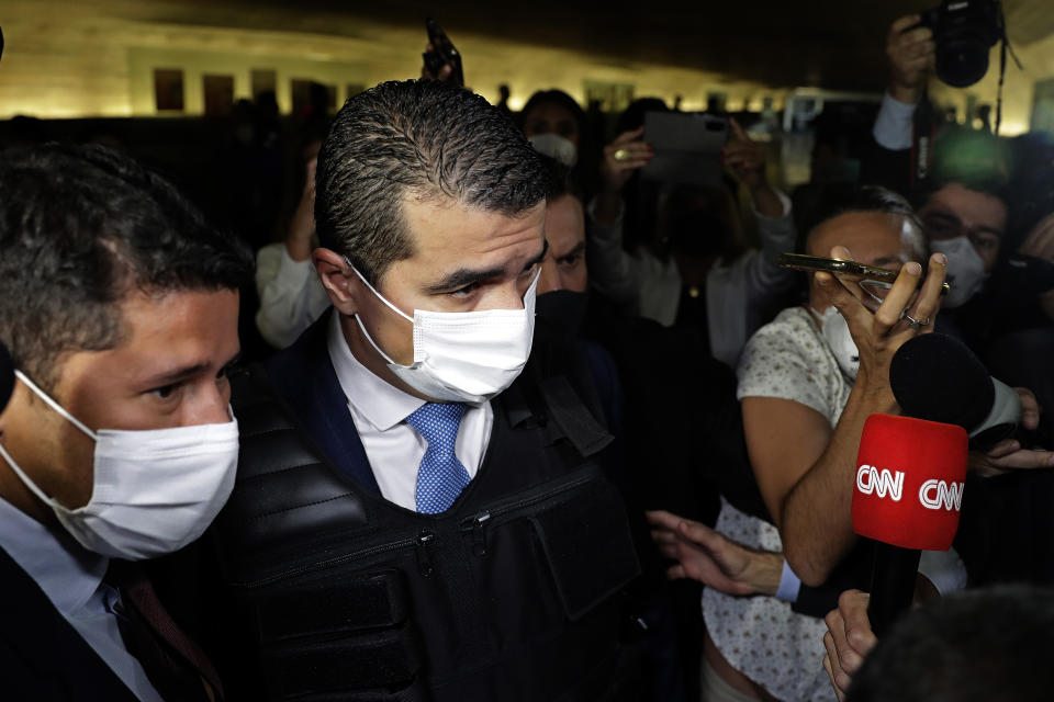 Deputy Luis Miranda, center, arrives to testify before the Senate for an investigation into the government's management of the COVID-19 pandemic, in Brasilia, Brazil, Friday, June 25, 2021. (AP Photo/Eraldo Peres)