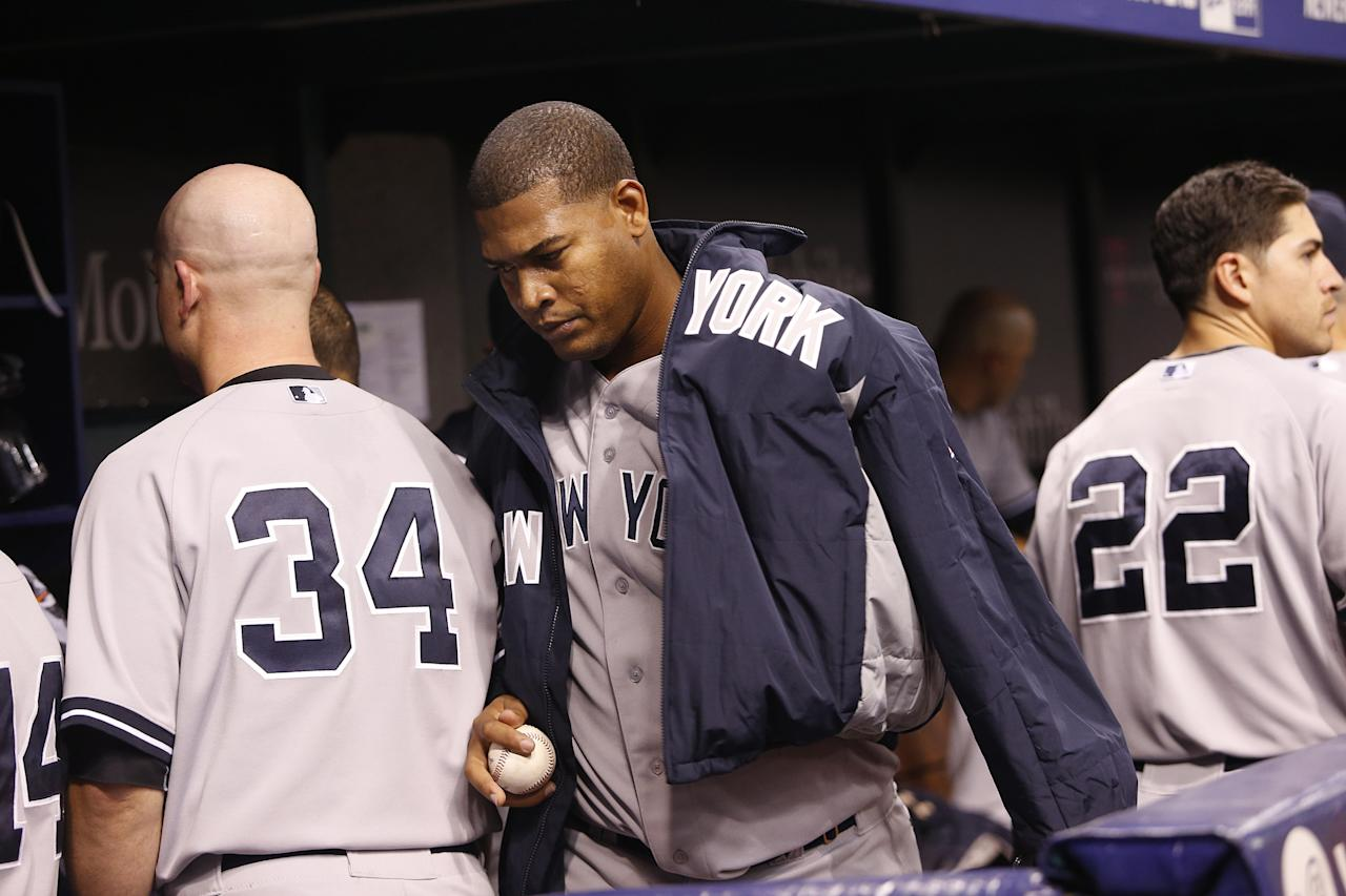 ST. PETERSBURG, FL - APRIL 19: Ivan Nova #47 of the New York Yankees walks through the dugout following the fourth inning of a game against the Tampa Bay Rays on April 19, 2014 at Tropicana Field in St. Petersburg, Florida. (Photo by Brian Blanco/Getty Images)