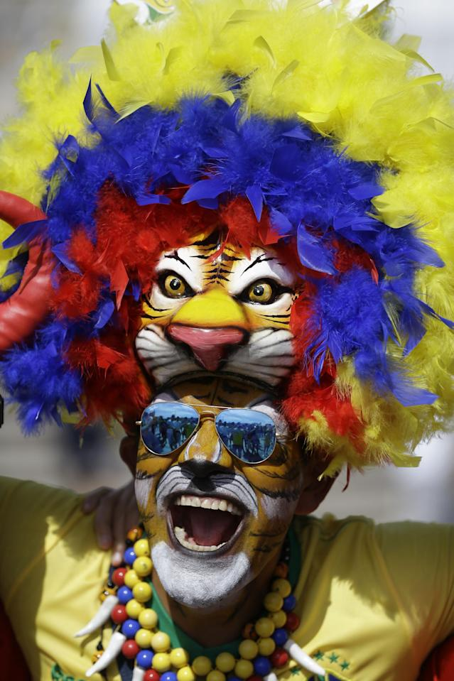 A fan cheers outside the Mineirao Stadium before the group H World Cup soccer match between Belgium and Algeria, in Belo Horizonte, Brazil, Tuesday, June 17, 2014. (AP Photo/Sergei Grits)