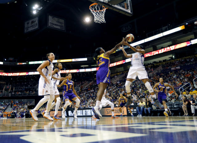 Phoenix Mercury's Briana Gilbreath, right, battles Los Angeles Sparks' Jantel Lavender for the rebound as Sparks' Lindsey Harding, center, and Mercury's Diana Taurasi, left, and DeWanna Bonner look on during the first half of Game 2 of a WNBA basketball Western Conference semifinal series, Saturday, Sept. 21, 2013, in Phoenix. (AP Photo/Matt York)