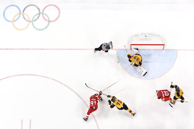<p>Nikita Gusev #97 of Olympic Athlete from Russia shoots and scores against Dominik Kahun #72 and Danny Aus Den Birken #33 of Germany in the third period during the Men's Gold Medal Game on day sixteen of the PyeongChang 2018 Winter Olympic Games at Gangneung Hockey Centre on February 25, 2018 in Gangneung, South Korea. (Photo by Bruce Bennett/Getty Images) </p>
