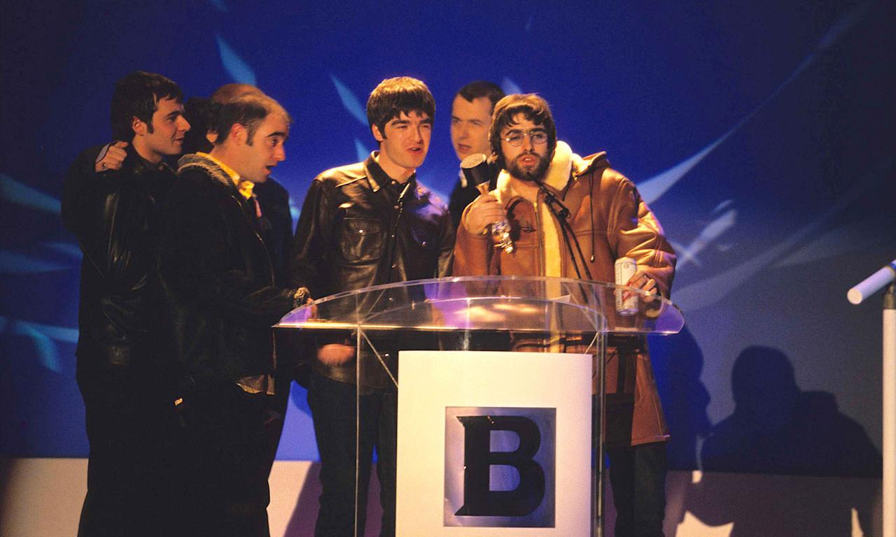 """Brit-pop bad boys Oasis have a grand total of six Brit awards, earning their first in 1995 with British Breakthrough Act. They went on to further acclaim during 1996 when they won three prizes, Best Group, Album and Video. After becoming hugely influential, they won the Outstanding Contribution in 2007 but Liam Gallagher went on to make a very memorable display in 2010 when he collected the award for Best British Album for <em>(What's the Story?) Morning Glory</em> alone and ended up <a href=""""https://www.music-news.com/news/UK/32546/Read"""">chucking the trophy and the microphone into the audience</a>. (Photo by Fred Duval/FilmMagic)"""