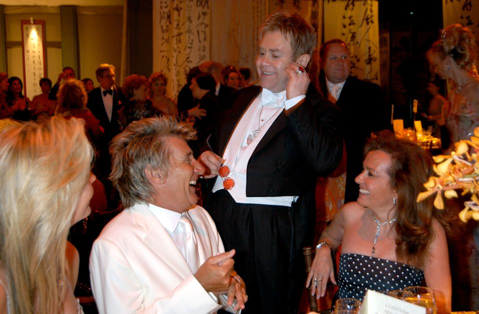 Penny Lancaster, Rod Stewart and Sir Elton John during The 6th Annual White Tie & Tiara Ball to Benefit the Elton John Aids Foundation in Association with Chopard - Show And Dinner at Sir Elton John Residence in Windsor, United Kingdom. (Photo by Harry Nicholls/WireImage)