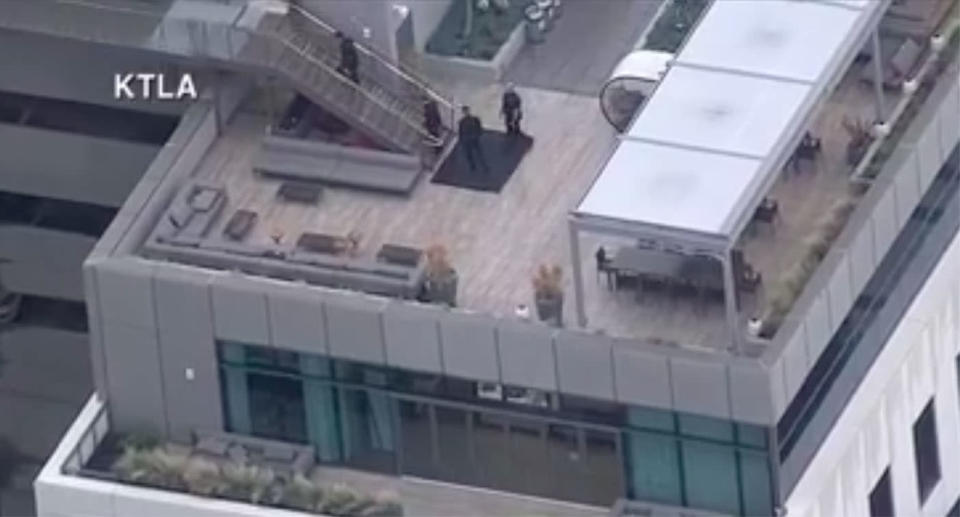 Police officers were seen on the rooftops of the buildings in the studio. Source: KTLA